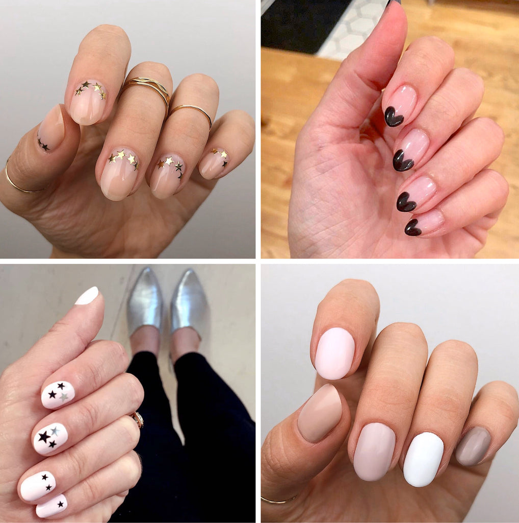 Stars, black hearts and minimal nail color art on female model hand