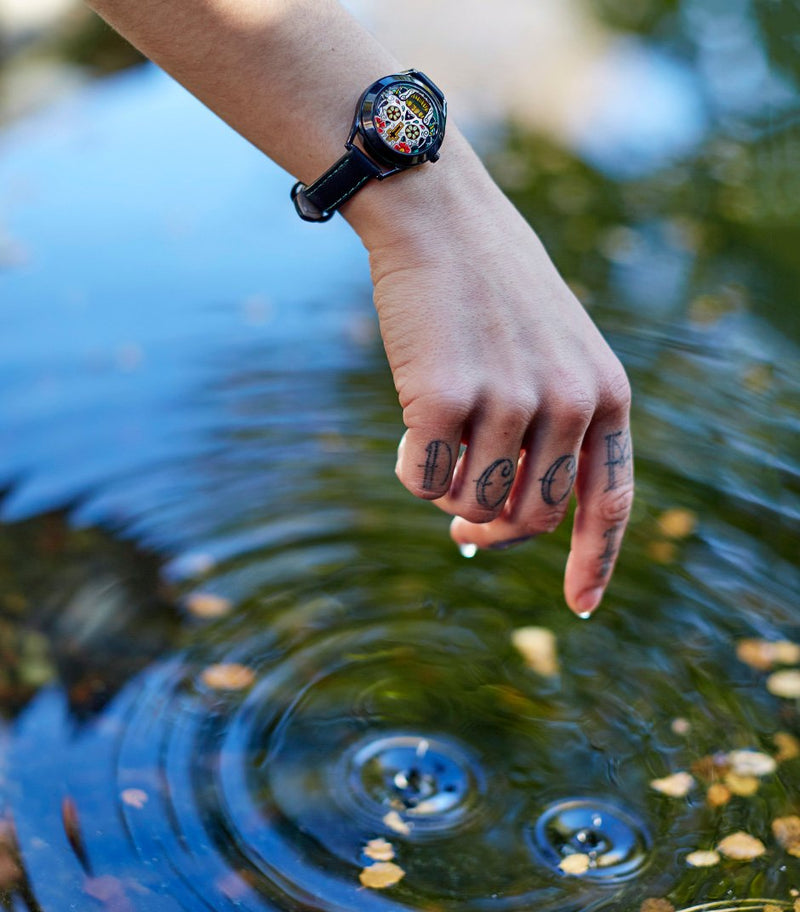 The Last Laugh Tattoo ladies watch - on models wrist near water