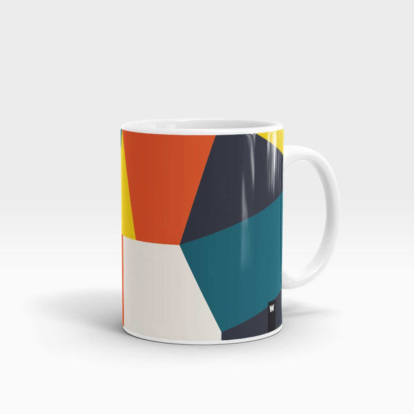 mug with abstract shape pattern in white, teal, navy , red and yellow colours with white handle