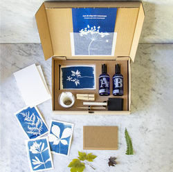 open cyanotype kit box showing what's included in front of a marble background/
