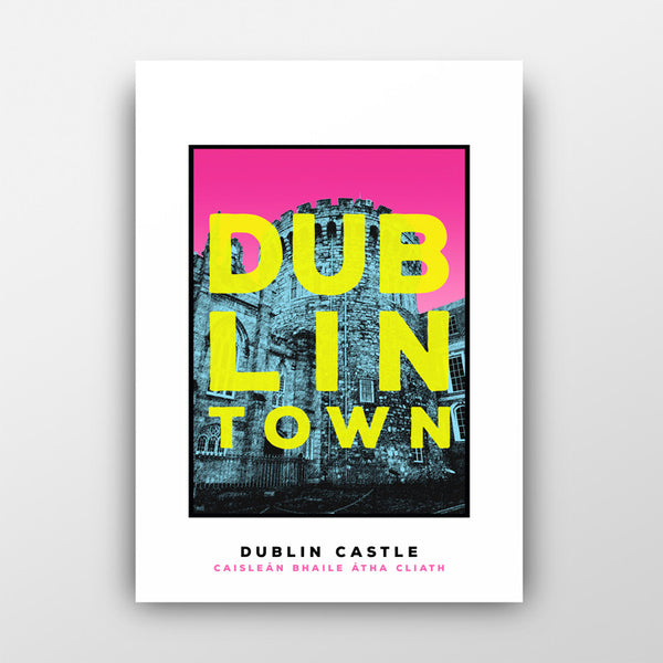print of blue dublin castle with pink sky. green text 'dublin town' over the image. white background behind the print