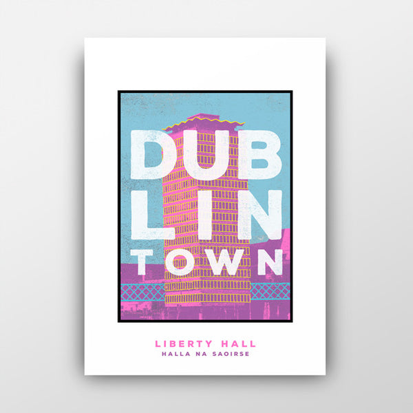 print of pink liberty hall with blue sky. white text 'dublin town' over the image. white background behind the print