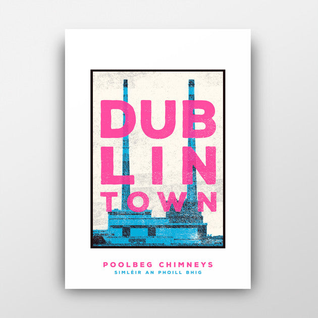 print of blue poolbeg chimneys with white sky. pink text 'dublin town' over the image. white background behind the print