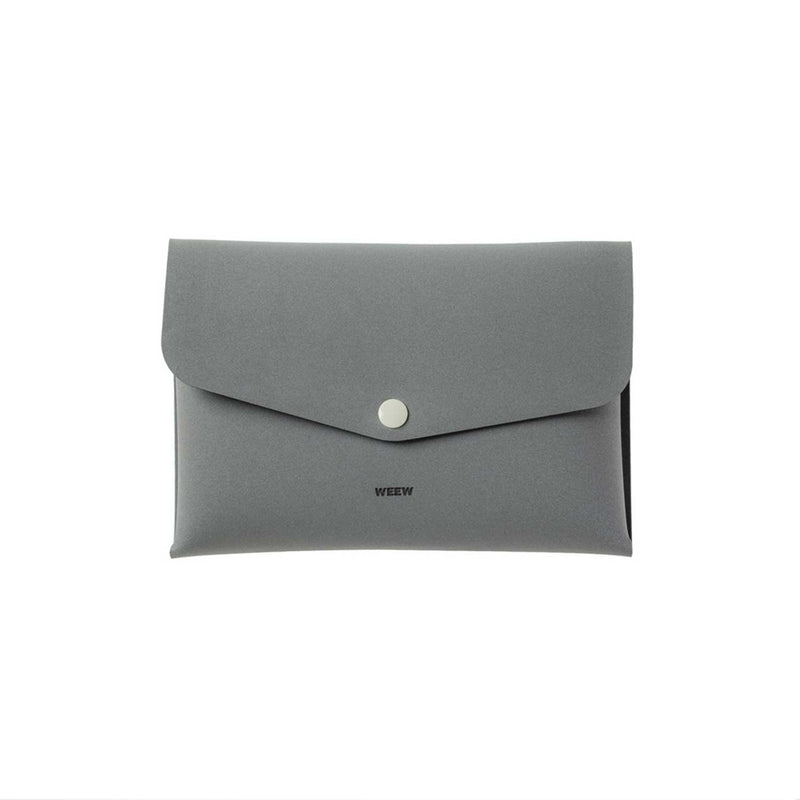 grey case with closed flap and grey button against a white background