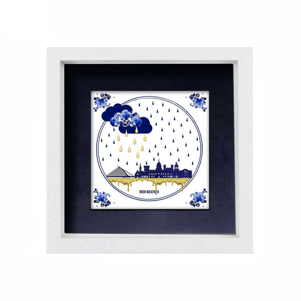 ceramic tile with navy blue dublin skyline , gold and navy blue raindrops and navy vlue clouds. behind the tile is a navy blue background and it is in a white frame. white display background