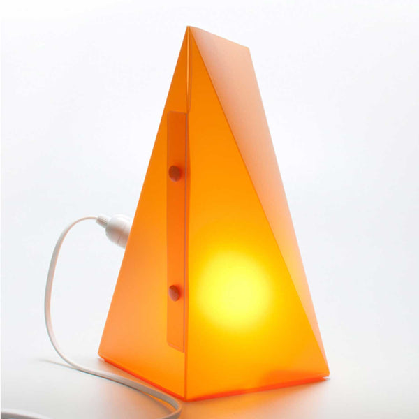orange triangle lamp with lit bulb inside two buttons on front and white cord attached on left side of lamp