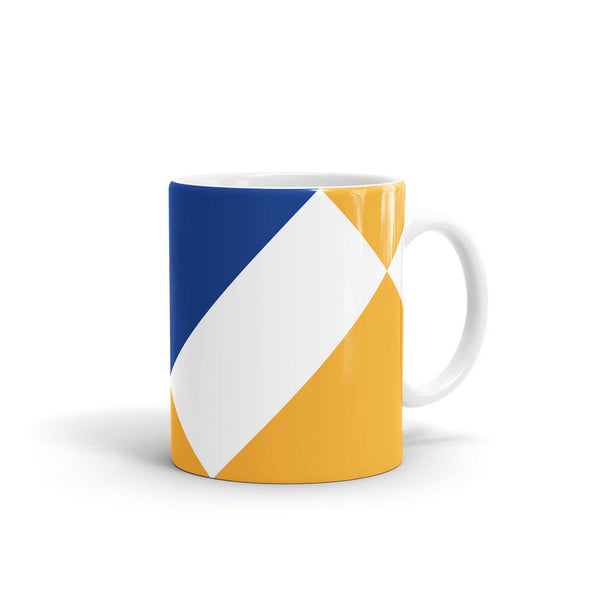 blue and yellow mug with white rectangle across front and white handle against a white background