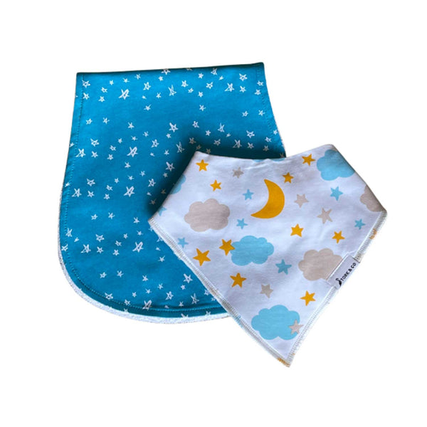 blue burp bib with white stars behind a white bandana bib with moon stars and clouds