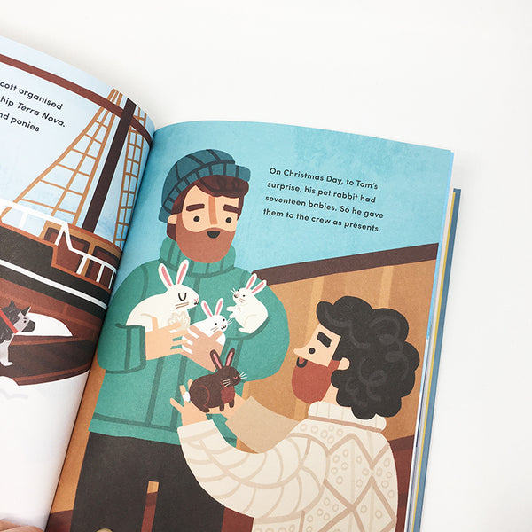 angled view of a page from book. tom crean holds three white rabbits and another male character is holding a brown rabbit. there is black text.