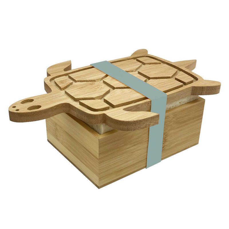 Wooden box with turtle shaped lid attached by a grey band lid slightly ajar with tofu showing in box
