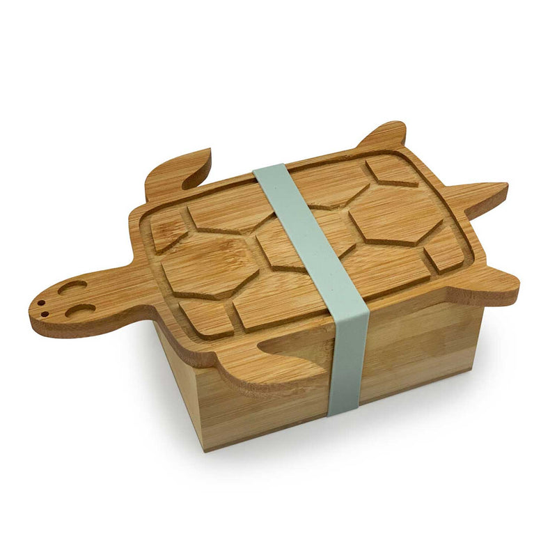 top view of wooden box with a turtle shaped lid and grey strap holding lid and box together