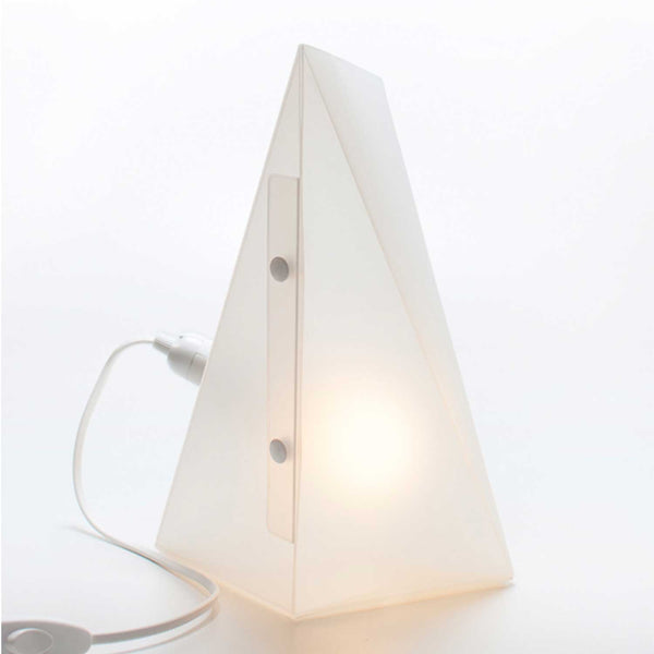 white triangle lamp with lit bulb inside two buttons on front and white cord attached on left side of lamp