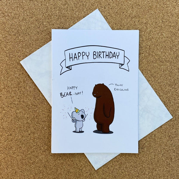 a koala trying to celebrate a grizzly bear's birthday - a card by rob stears