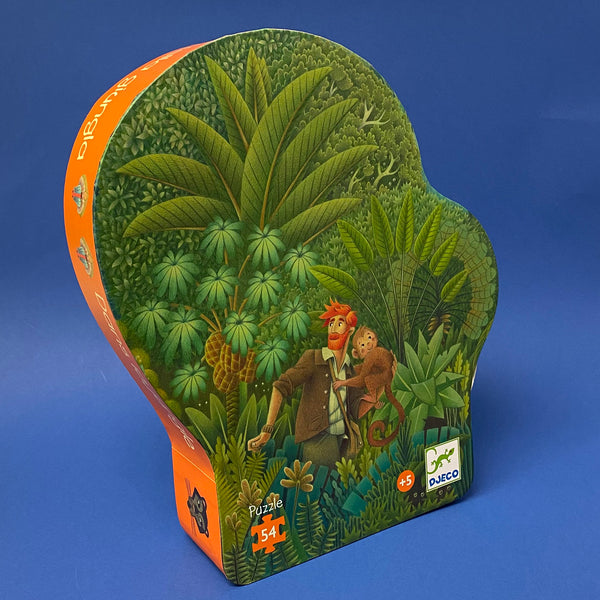 54 piece jungle jigsaw puzzle boxwith cartoon illustration of a man with a ginger beard carrying a brown hairded monkey through green foliage on a navy blue background