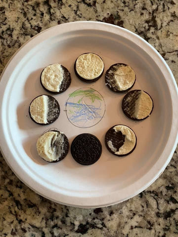 oreos on a white plate in a circle to look like the cycle of the moon