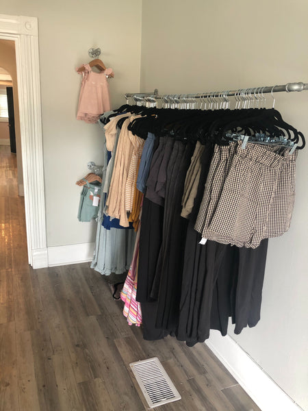 Racks of women's and baby clothes