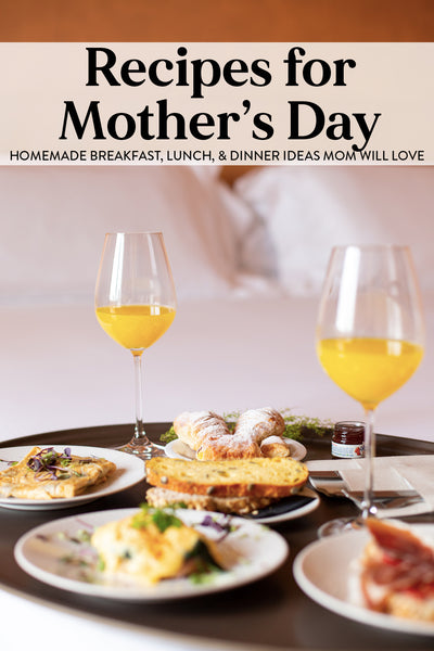 Graphic for Recipes for Mother's Day shows a breakfast in bed set up with plates of food and glasses of orange juice on a tray on a bed