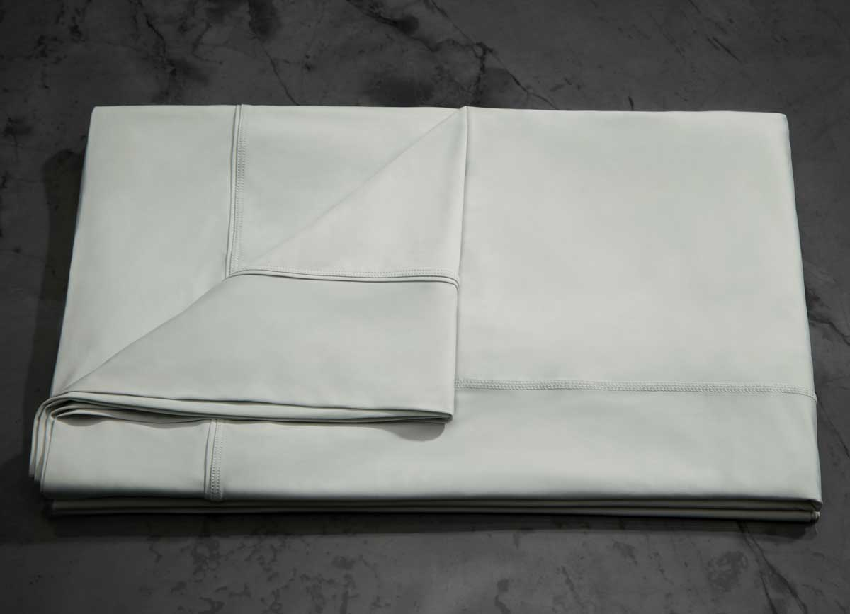 MIDNIGHT LABEL Flat Sheet shown in mist gray, folded #choose-your-color_mist-gray