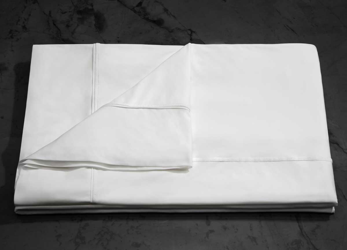 MIDNIGHT LABEL Flat Sheet shown in porcelain folded #choose-your-color_porcelain