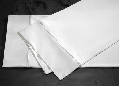 midnight label pillowcase stack shown in porcelain #choose-your-color_porcelain