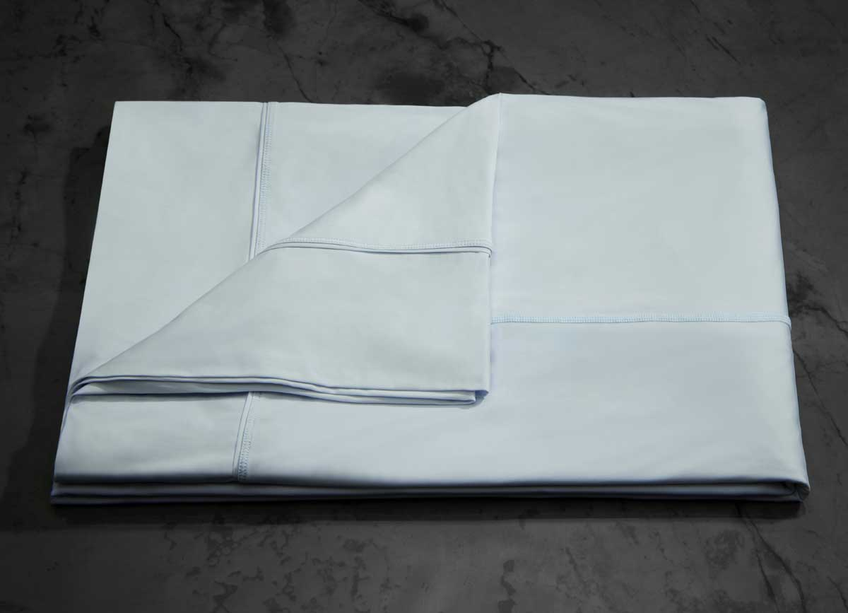 MIDNIGHT LABEL Flat Sheet shown in spa blue, folded #choose-your-color_spa-blue