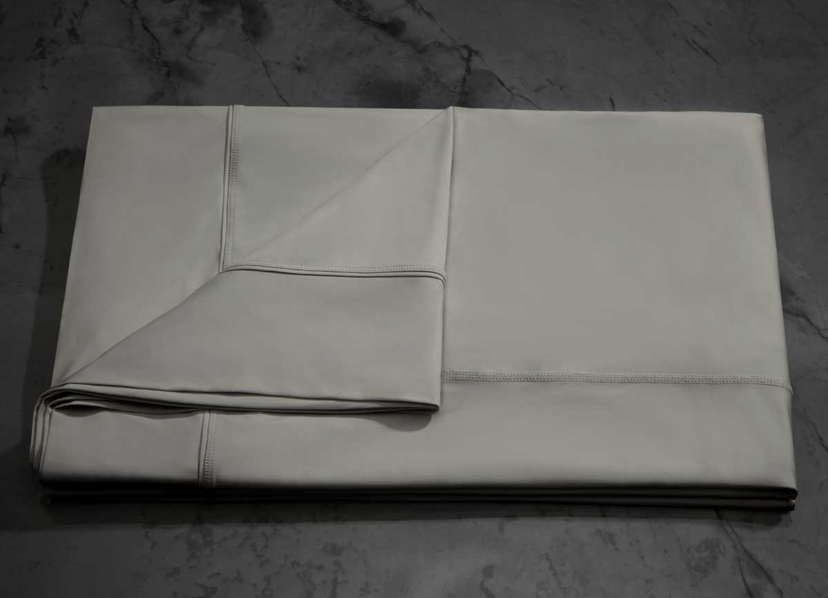 MIDNIGHT LABEL Flat Sheet shown in stone, folded #choose-your-color_stone