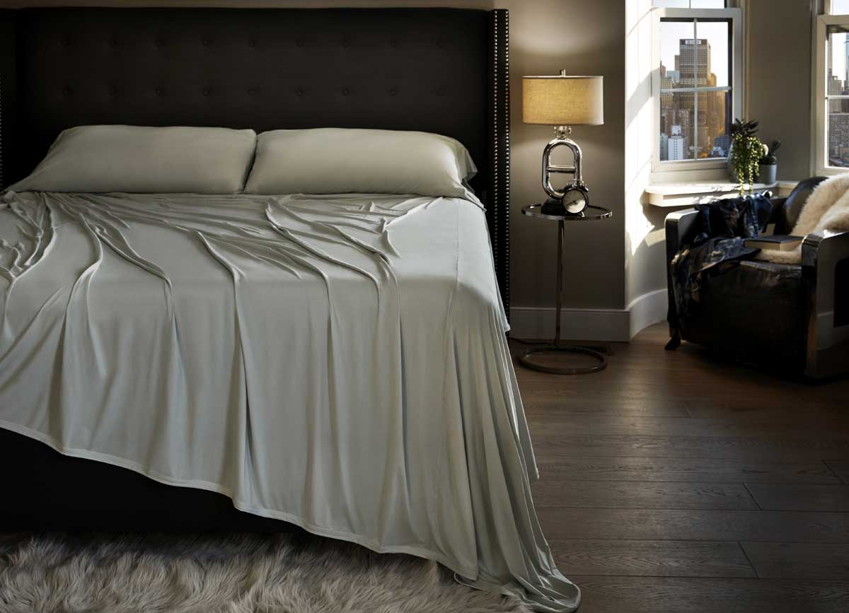 Lifestyle image of MIDNIGHT LABEL Flat Sheet shown in mist gray #choose-your-color_mist-gray