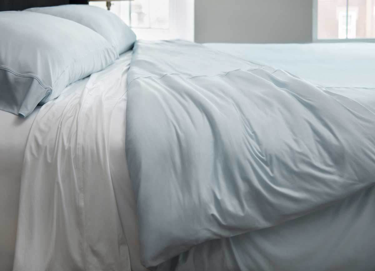 Lifestyle of Midnight Label Duvet Cover shown on bed in Spa Blue #choose-your-color_spa-blue
