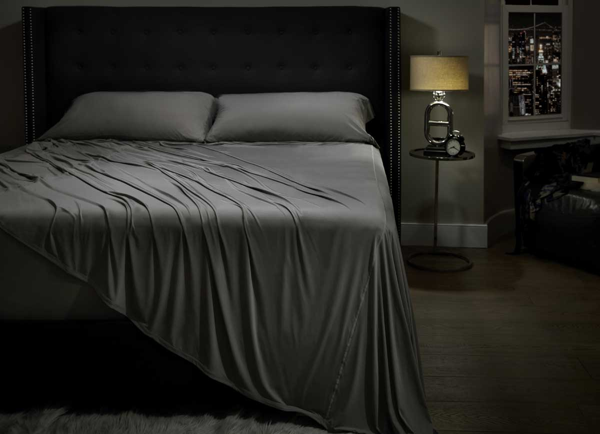 Lifestyle image of MIDNIGHT LABEL Flat Sheet shown in stone  #choose-your-color_stone