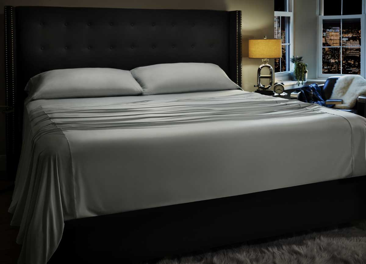 MIDNIGHT LABEL Flat Sheet shown in Mist Gray on bed #choose-your-color_mist-gray