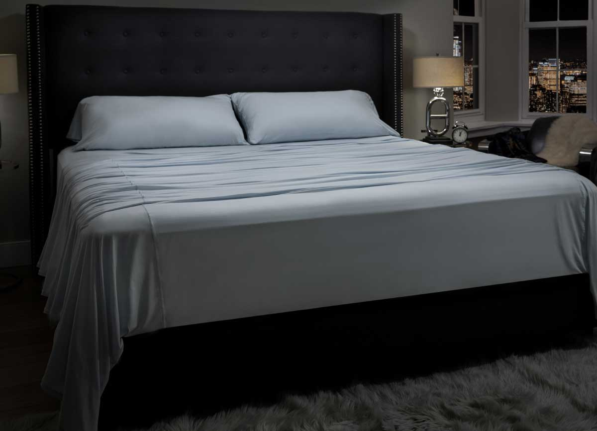 lifestyle image of MIDNIGHT LABEL Flat Sheet shown in spa blue #choose-your-color_spa-blue