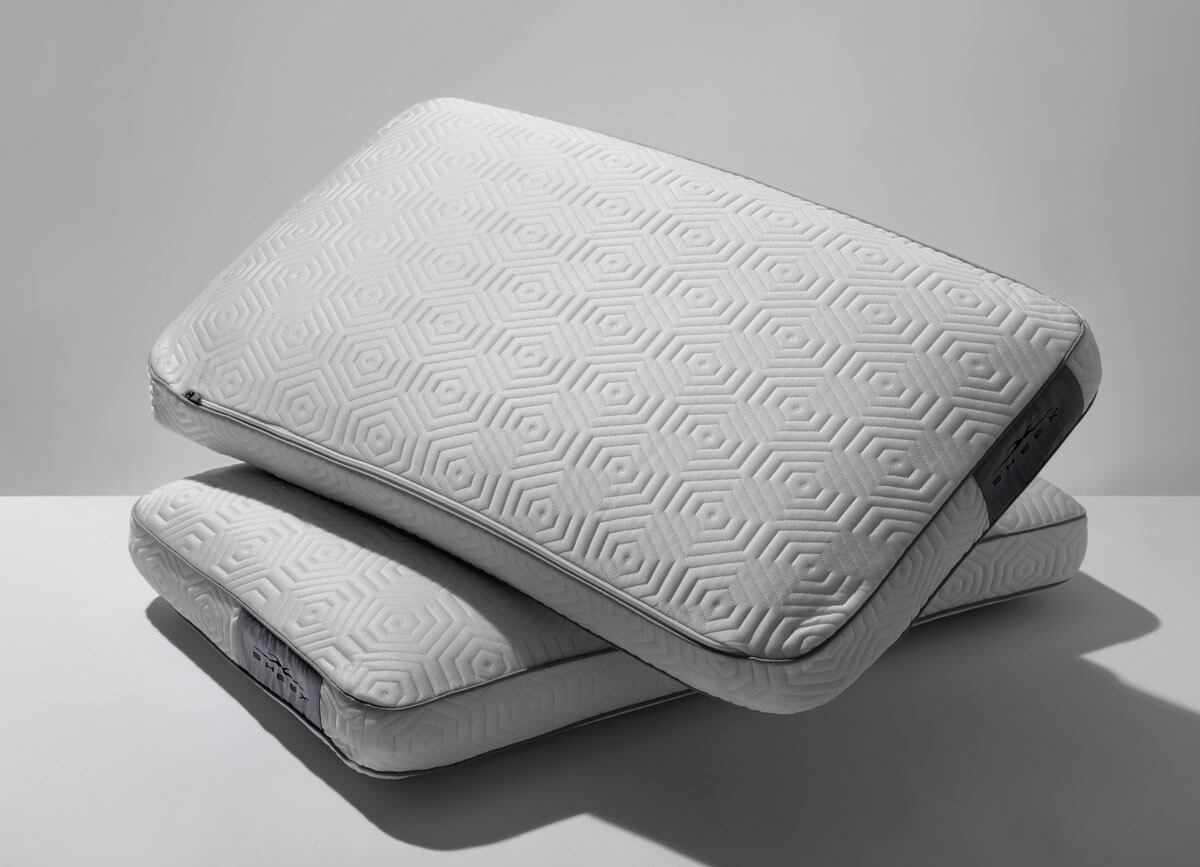 Lifestlye image of two Infinite Zen Performance Pillows stacked