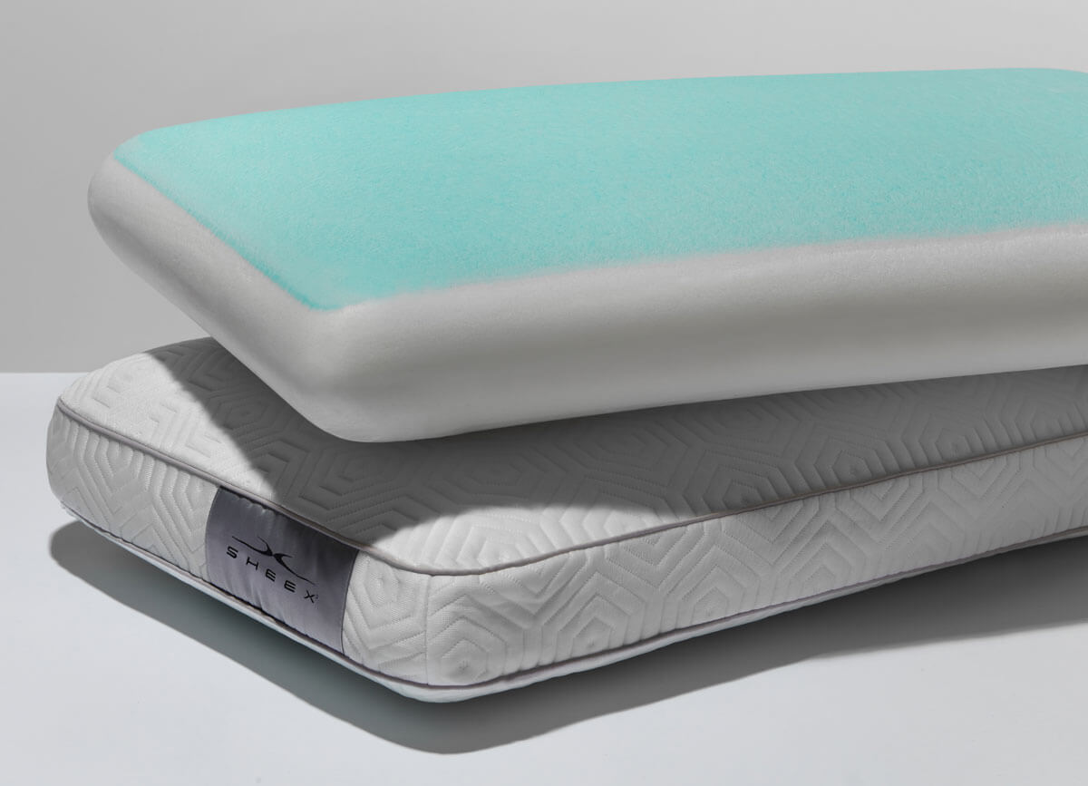 Lifestyle image of two Infinite Zen Performance Pillows Stacked