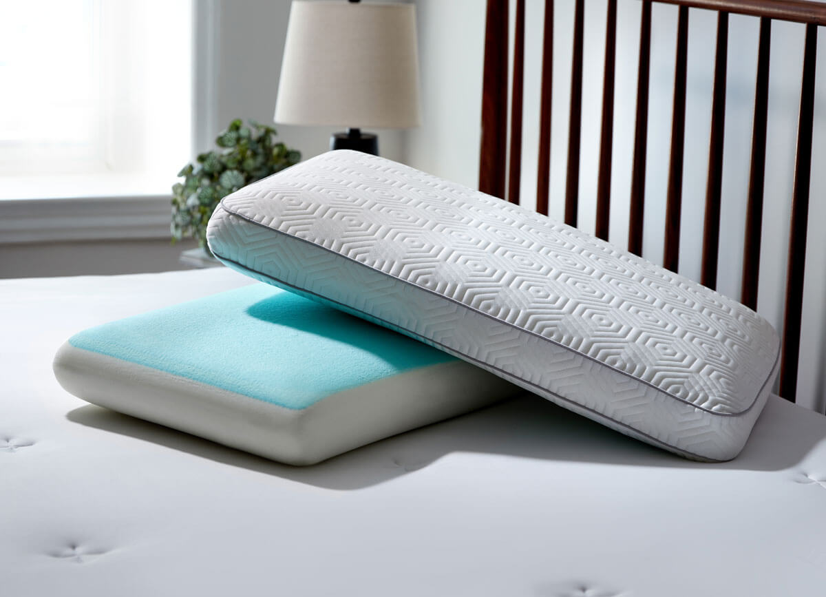 Lifestyle of stacked Infinite Zen Performance Pillows on bed