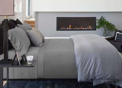 Luxury Copper Sheet Set on bed in Light Gray #choose-your-color_light-gray