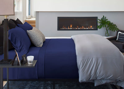 Luxury Copper Sheet Set on bed in Navy #choose-your-color_navy