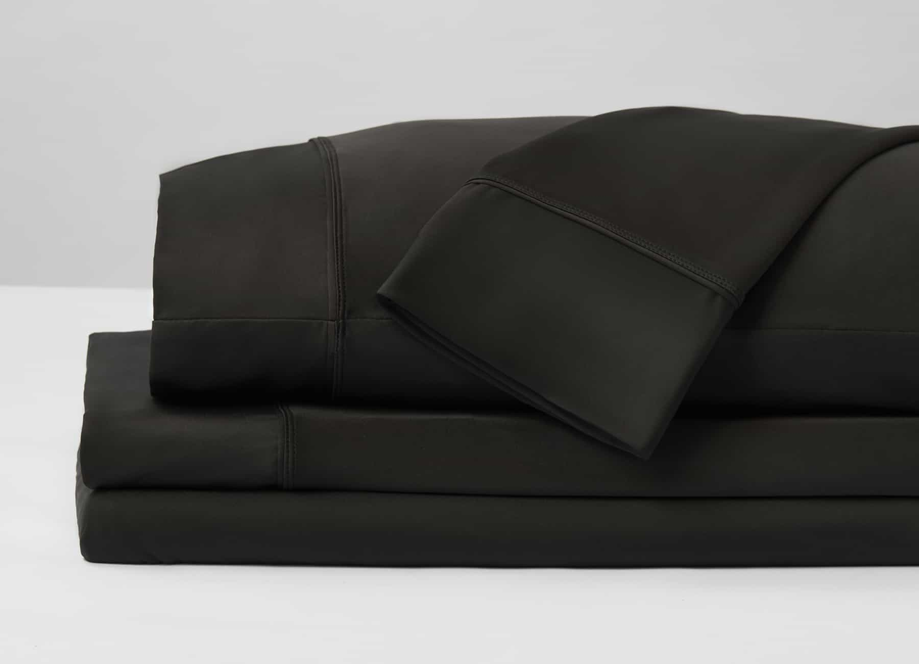 Original Performance Sheet Set Image Shown Folded and Stacked in Black #choose-your-color_black