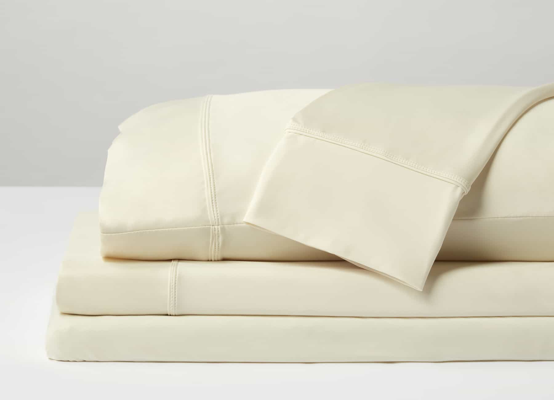 Original Performance Sheet Set Image Shown Folded and Stacked in Ecru #choose-your-color_ecru