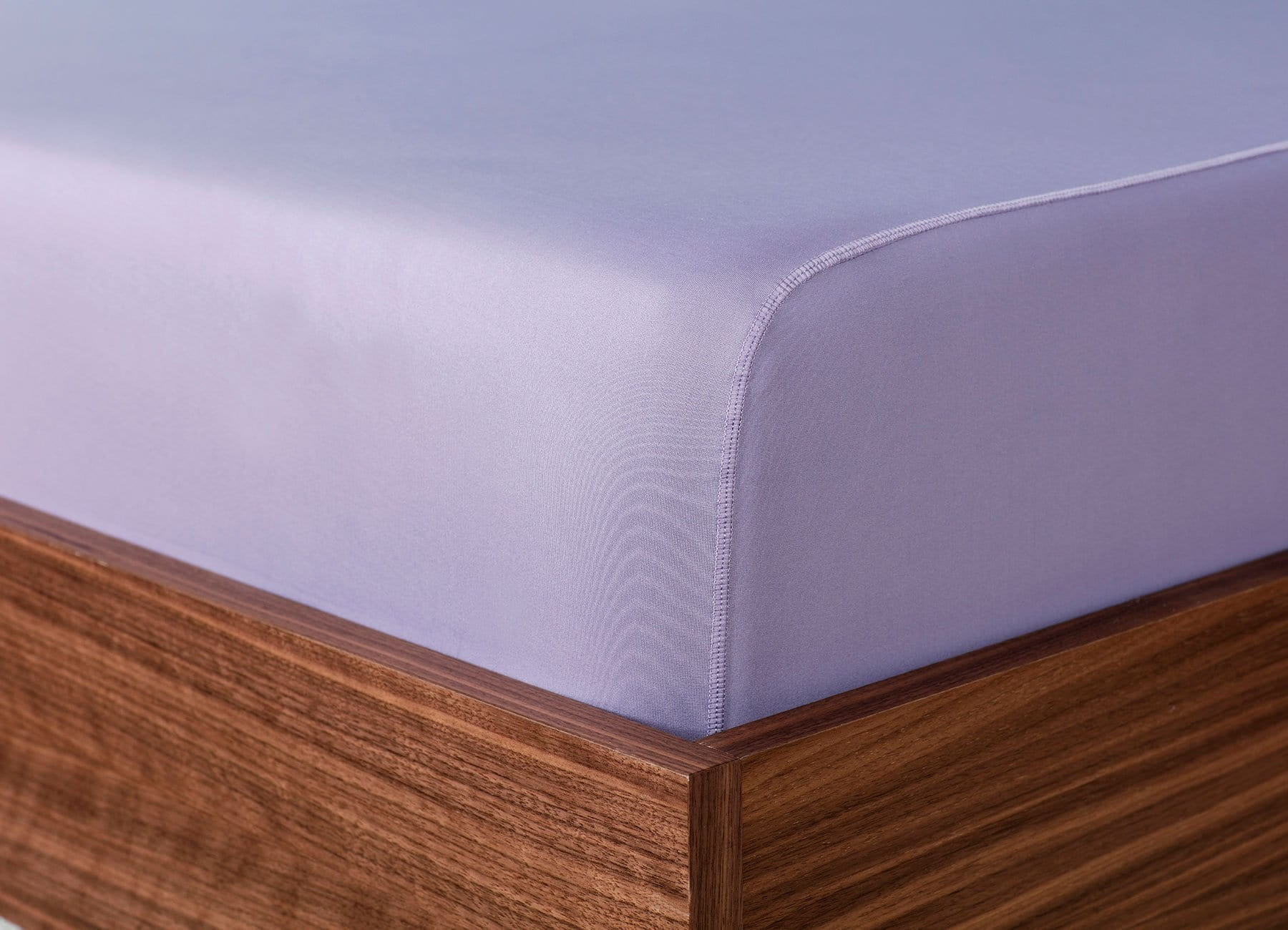 Original Performance Fitted Sheet on bed in Lavender #choose-your-color_lavender