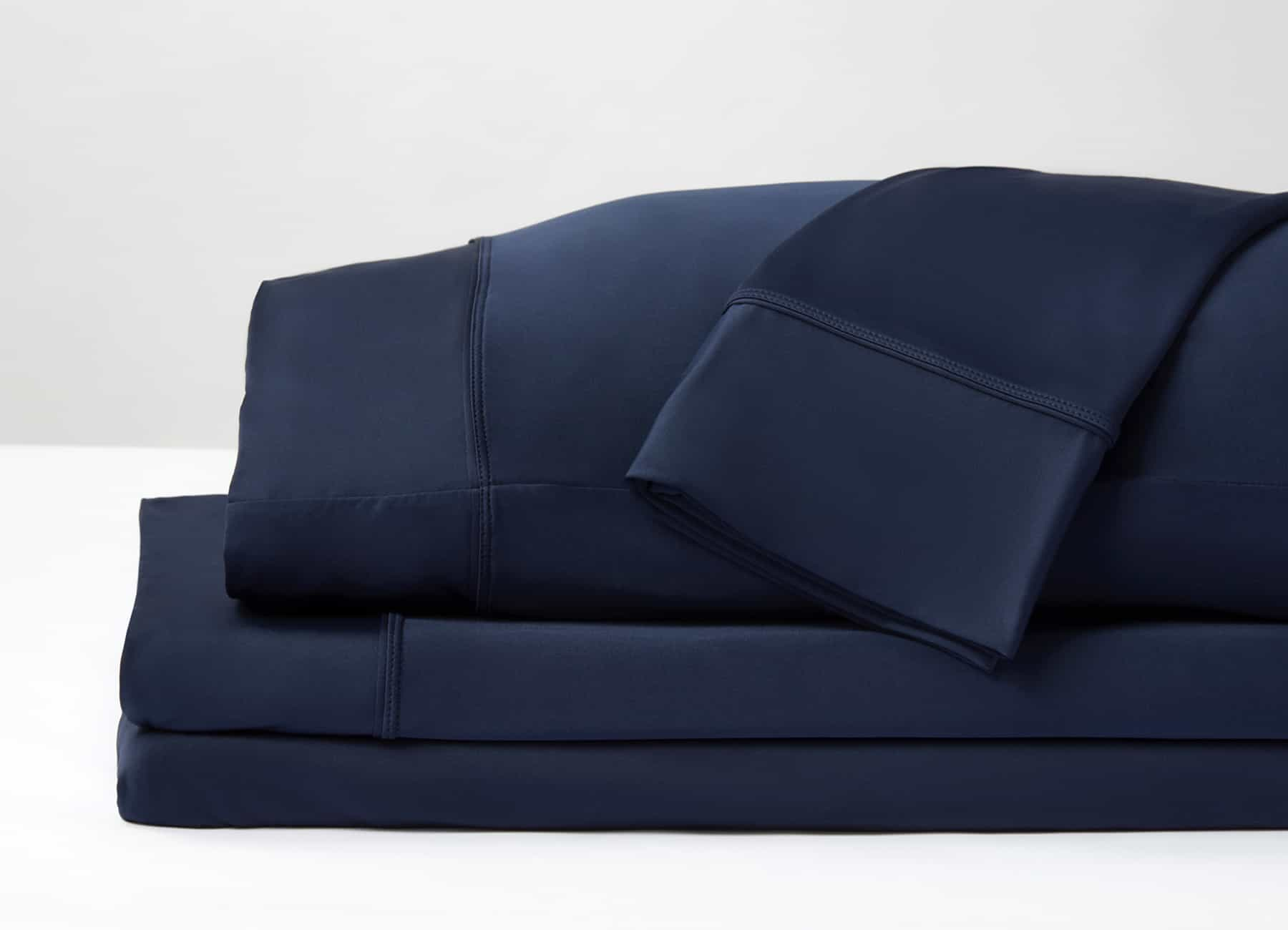 Original Performance Sheet Set Image Shown Folded and Stacked in Navy #choose-your-color_navy