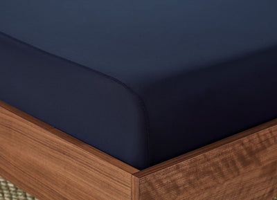 Original Performance Fitted Sheet on bed in Navy #choose-your-color_navy