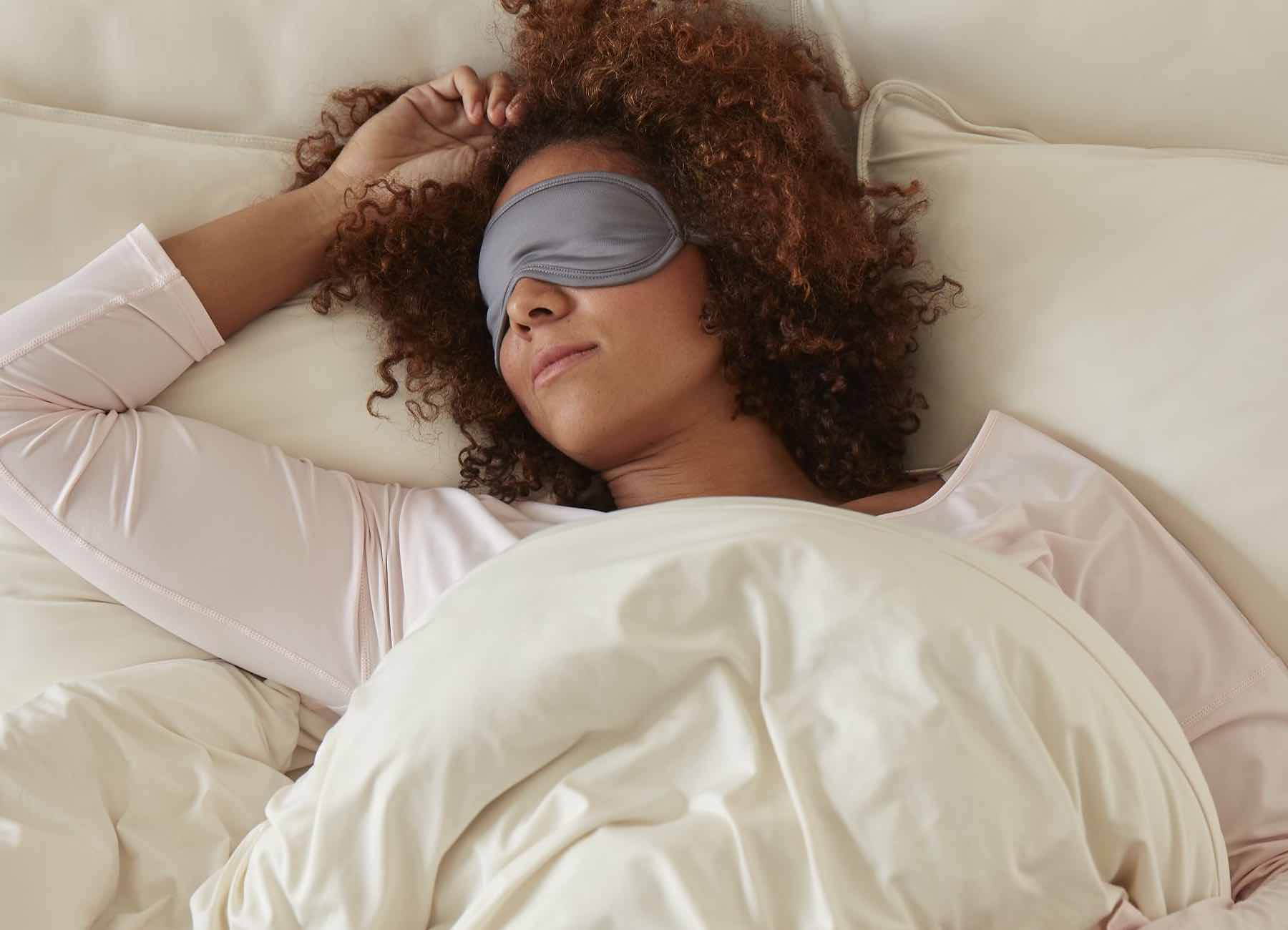 SHEEX Sleep Mask in Graphite on model in bed