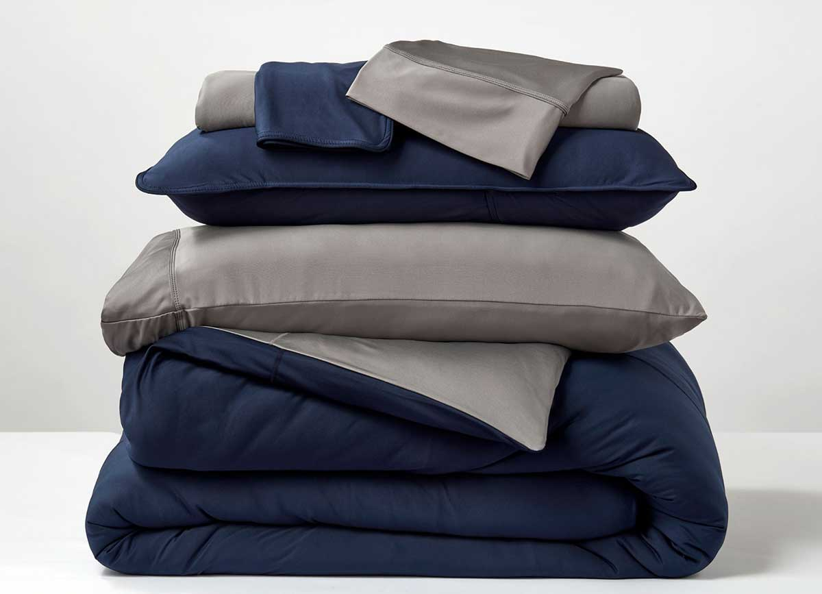 Studio Tech Bedding in navy and graphite in room environment #choose-your-color_navy-graphite