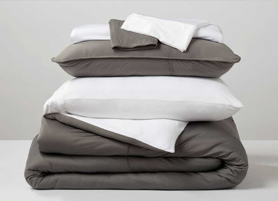 Studio Tech Bedding in Graphite and Bright White in room environment #choose-your-color_navy-graphite#choose-your-color_graphite-brtwhite