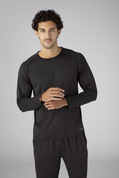 Model wearing SHEEX Men's Long Sleeve Tee in Black #choose-your-color_black