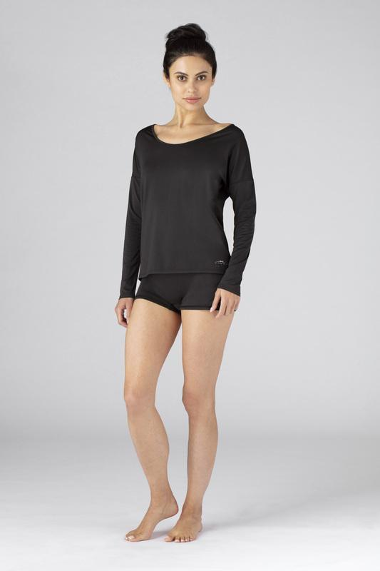 Model wearing the SHEEX Women's Open Back LS Tee in Black #choose-your-color_black