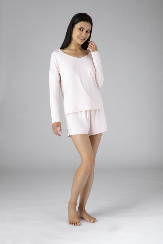 Model wearing the SHEEX Women's Open Back LS Tee in Blush Pink #choose-your-color_blush-pink