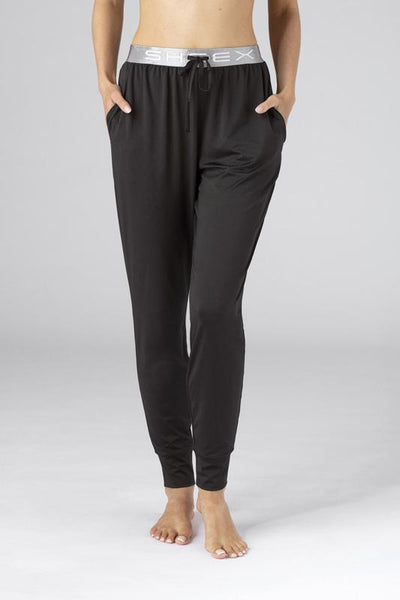Model wearing SHEEX Women's Modern Jogger in black #choose-your-color_black