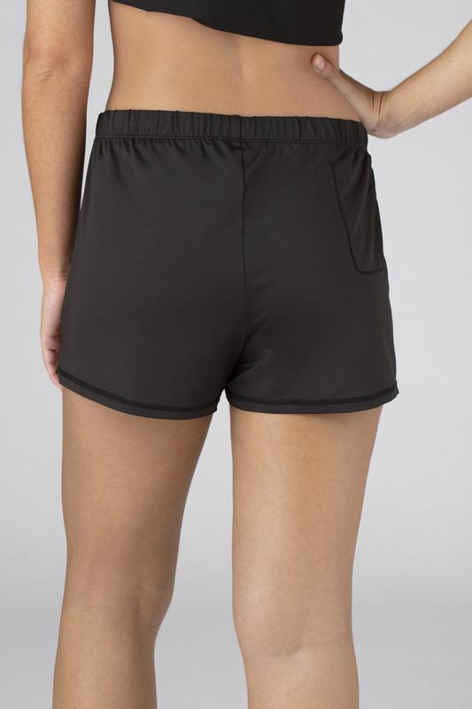 Model wearing the SHEEX Women's P.J. Shorts in black #choose-your-color_black