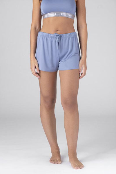 Model wearing SHEEX Women's P.J. Shorts in Light-Blue